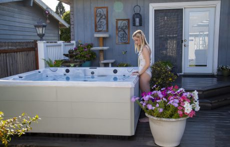 girl standing next to the hot tub