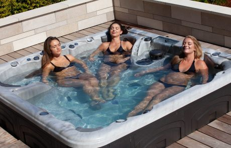 Girls are relaxing in a hot tub