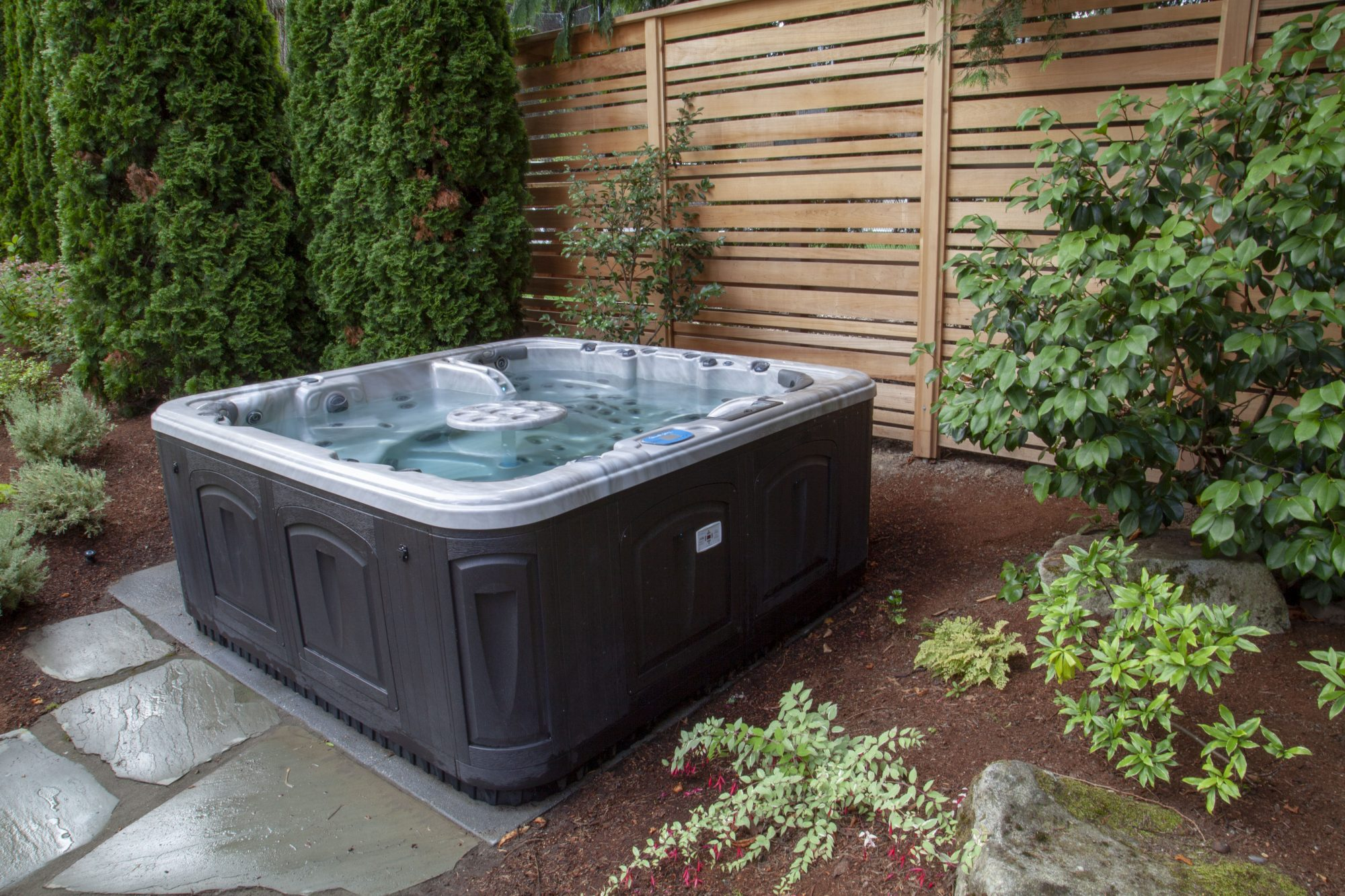 hot tub in a backyard