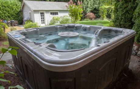 hot tub outside with a table